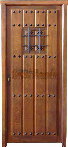 Modelo c 39 puerta r stica de madera exterior for Puertas principales de madera rusticas