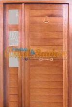 Puerta-moderna-iroko-fijo,montante,laterales barnizada a medida