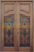 Puerta calle entrada 2 hojas iroko maciza clasica rustica amedida seguridad